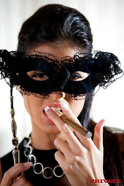 Dark haired babe smokes..