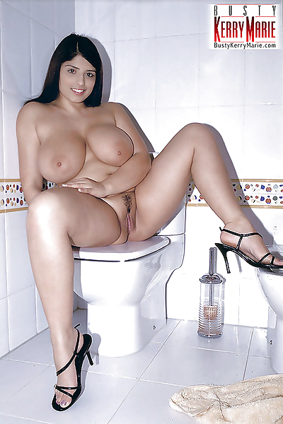 Euro babe Kerry Marie flaunts monster pornstar tits on toilet in bathroom