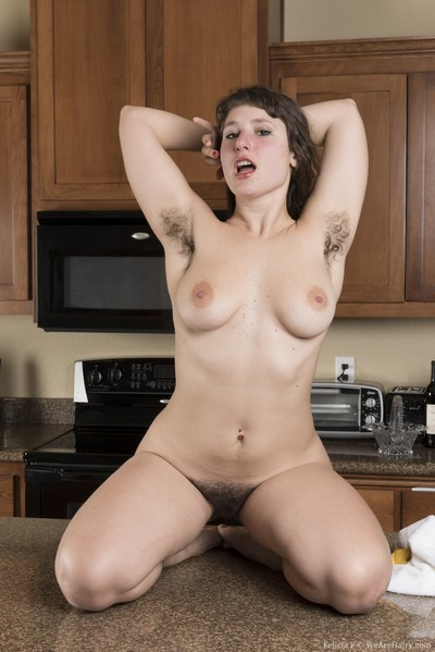 Done cleaning in the kitchen, Felicia F strips and climbs on the counter in her lingerie and denim shorts. On the..